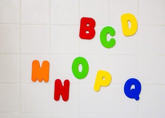 Foam letter ABCs on tile bath wall