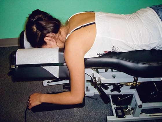 Woman on adjustment table 560