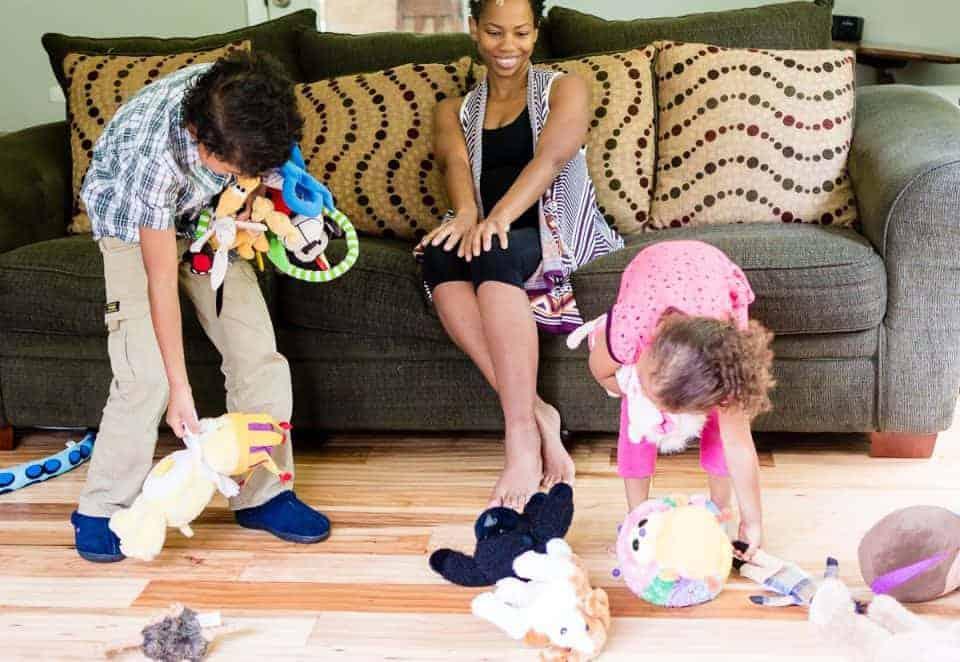 kids picking up toys