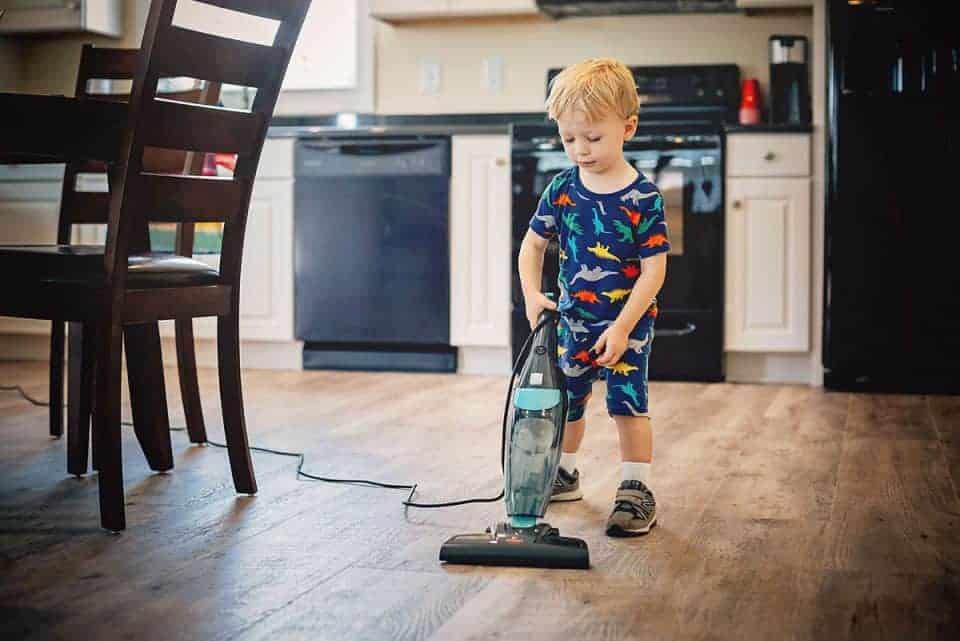 Child Vacuuming the floor DM